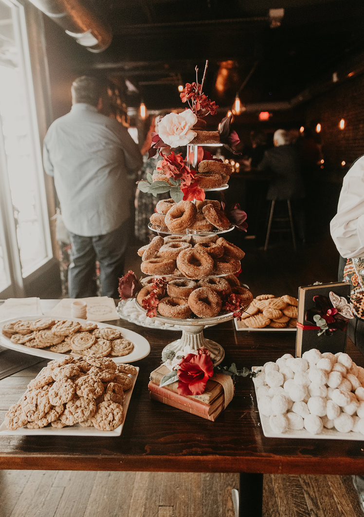 The wedding sweets table was done with lots of cookies and a cool donut tower with blooms