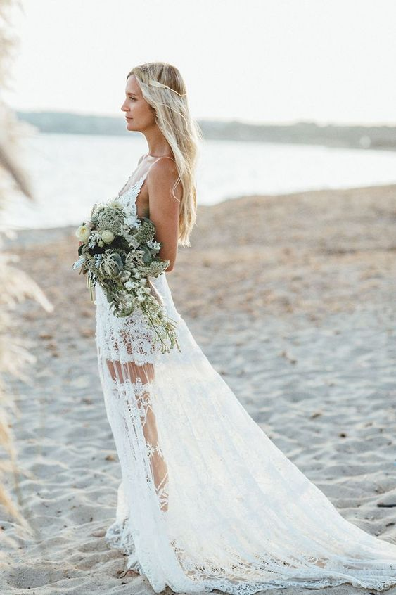 a boho lace A-line wedding dress with a deep neckline, spaghetti straps, an open back and a see-through skirt