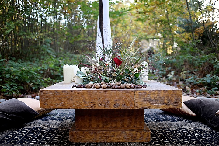 The picnic table was decorated with pebbles, nuts, greenery and bold flowers