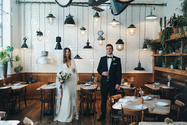 The reception was chic and cool, with a whole arrangement of black lamps