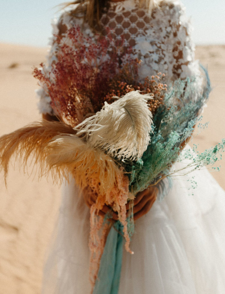 The wedding bouquet was done with spary painted grasses and feathers