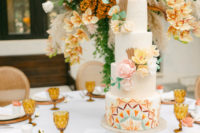 10 The wedding tablescape was done with lush florals and greenery, wicker chargers and amber glasses