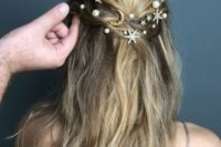 10 a messy twisted half updo with silver rhinestone stars and small and large pearl hair pins are two trends in one