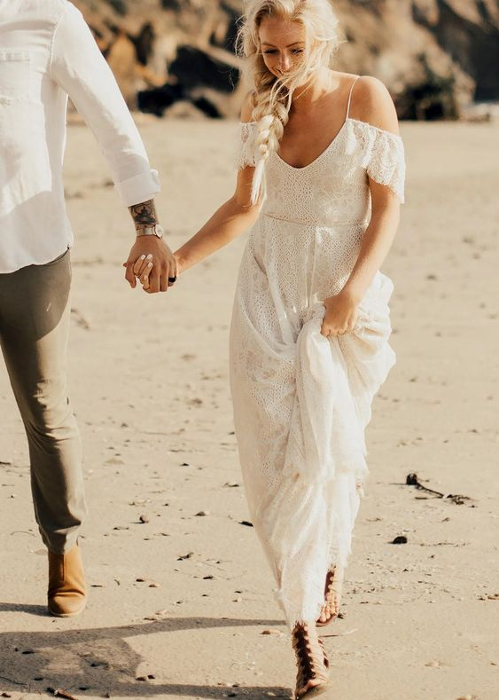 an off the shoulder boho lace beach wedding dress with a deep cut is a chic idea to rock