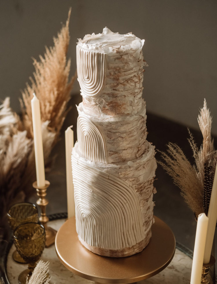 The wedding cake was a unique white textural one on a gold stand