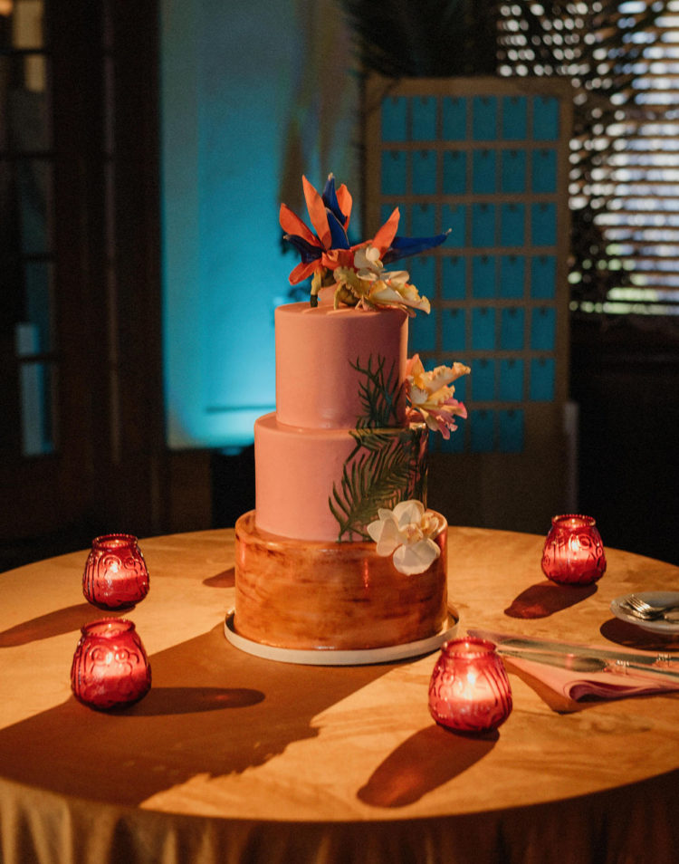 The wedding cake was pink and amber, with large tropical blooms and greenery