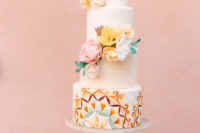 11 The wedding cake was white, with colorful painting and bright sugar and real blooms