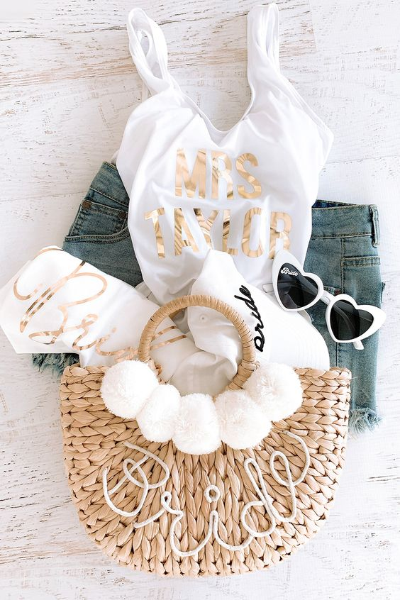 a cool bachelorette gift with a top, swimsuit, sunglasses and a towel for a beach-themed bachelorette