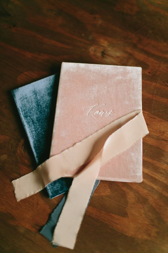 pretty crushed velvet upholstered wedding vow books look super chic