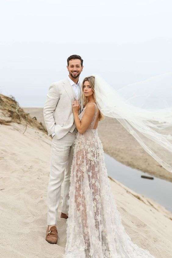 a romantic lace applique wedding dress with a cutout back and a long train will let you breathe