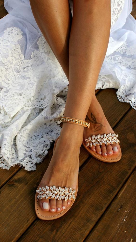 tan leather ankle strap heavily embellished wedding sandals are a nice and bold idea for a beach bride