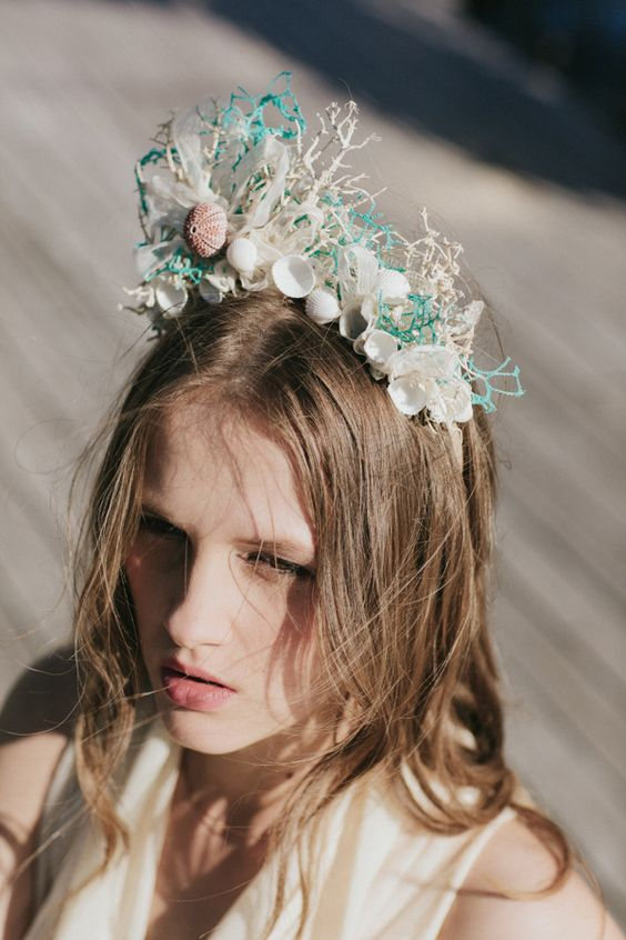 a very whimsical and bold crown with corals, urchins and seashells looks amazing