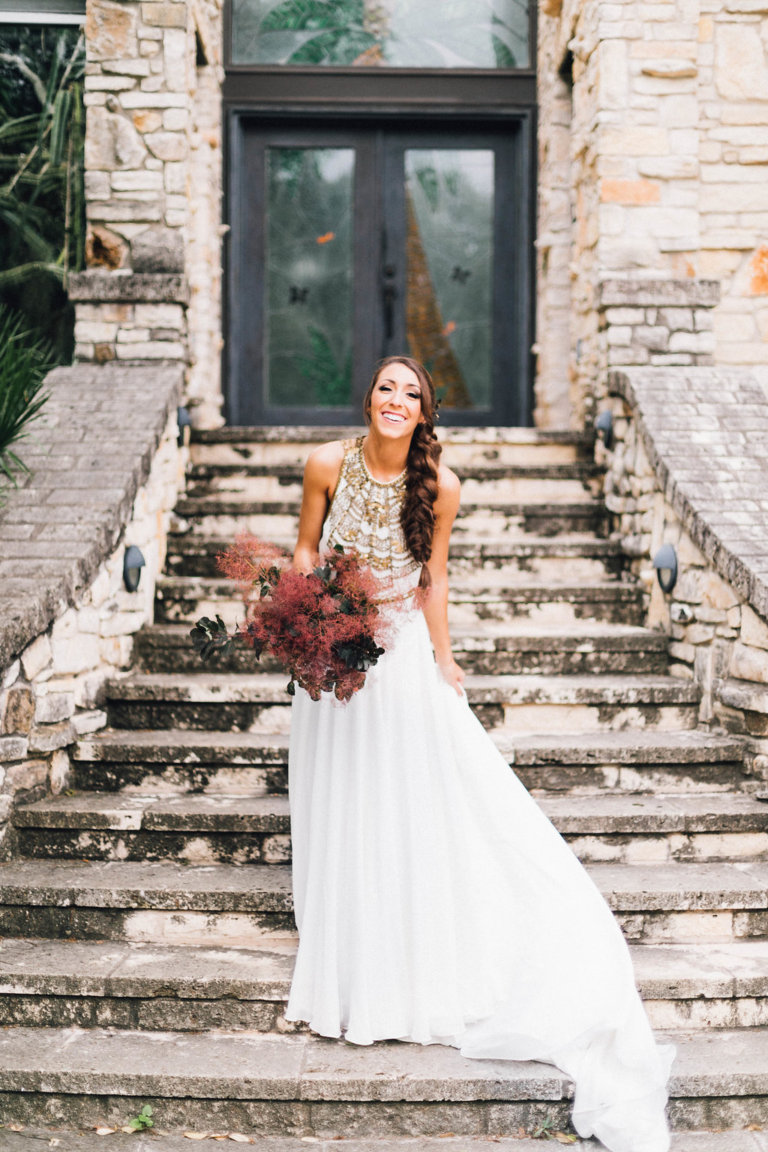 a dark leaf and burgundy smoke bush to contrast the neutral wedding dress and stand out a lot as much as possible