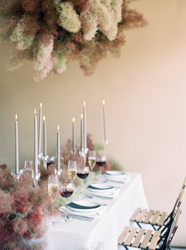 a smoke bush overhead installation and a matching table runner make the reception space fantastic and edgy
