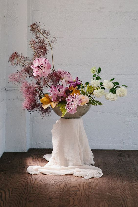 an ikebana-inspired wedding arrangement with pink and white blooms, smoke bush and greenery
