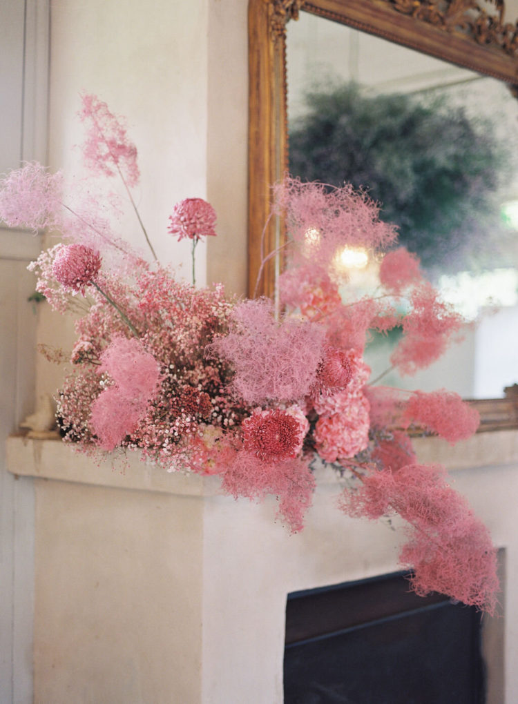sprayed smoke bush and some blooms for an unusual and bold wedding arrangement that inspires