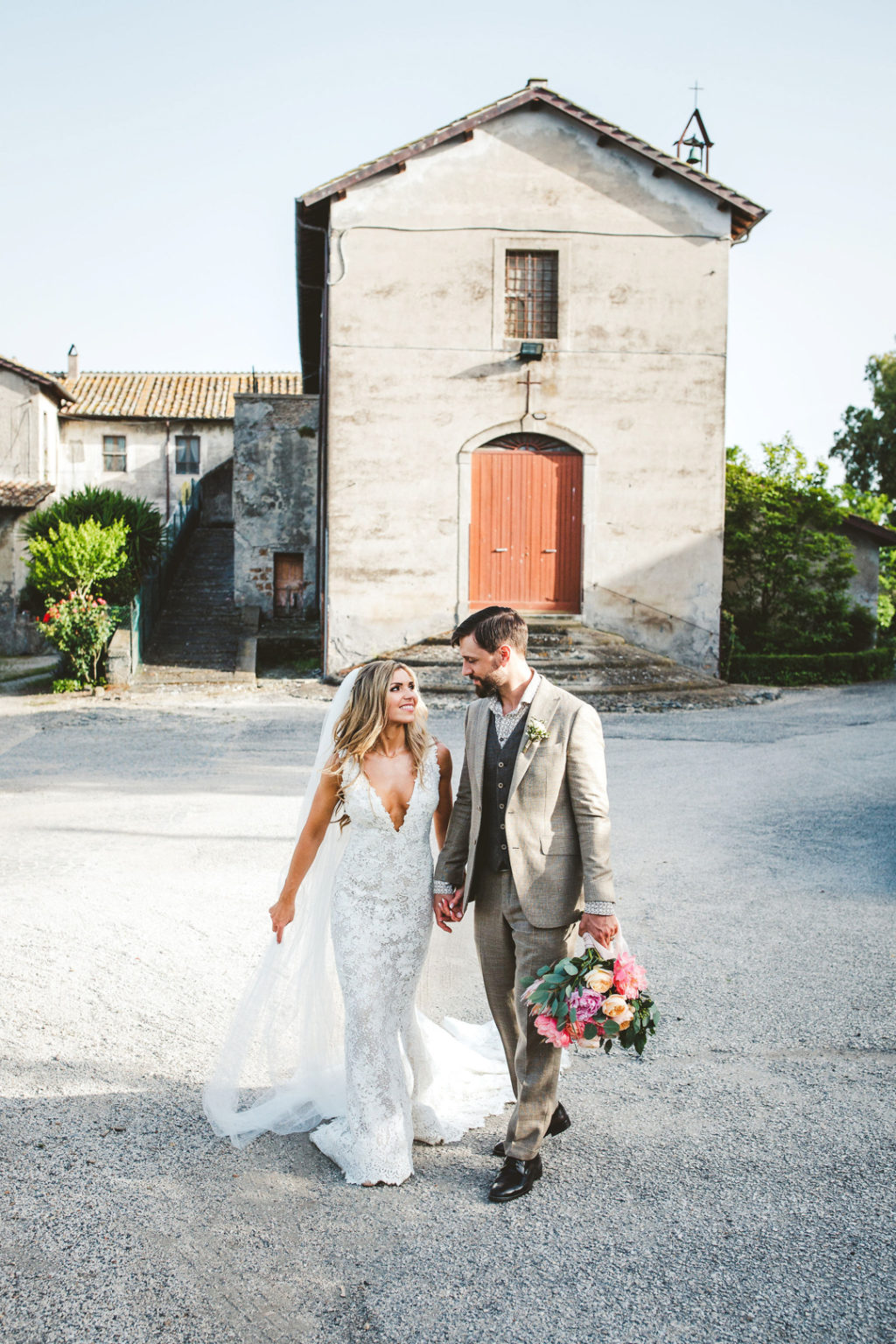 This lovely Norwegian couple went for a pretty Italian destination wedding with gorgeous florals