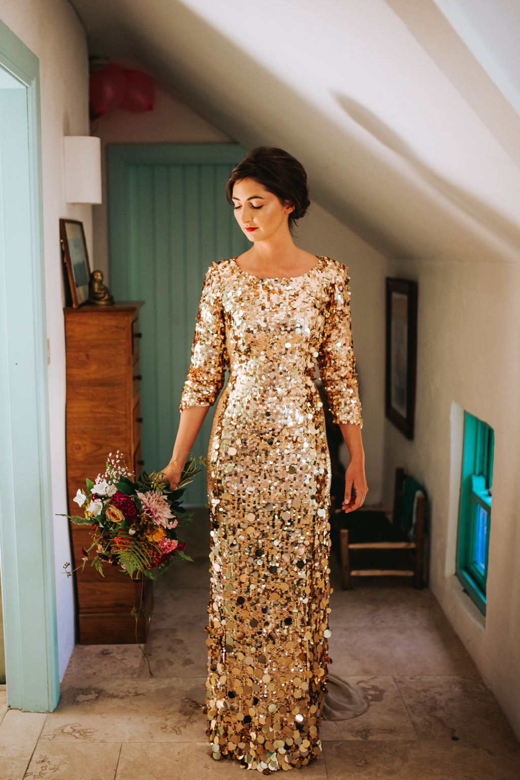 The bride was wearing a fantastic gold sequin wedding dress wiht shot sleeves