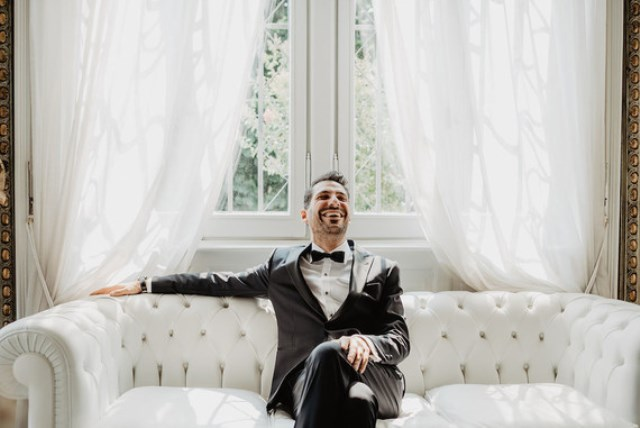 The groom was wearing a classic black tux