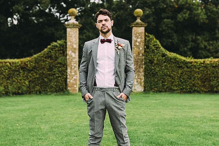 The groom was wearing a grey suit, burgundy suspenders and a matching bow tie
