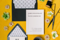 02 The wedding stationery was done in black and white and placed on a yellow runner to mark the wedding color scheme