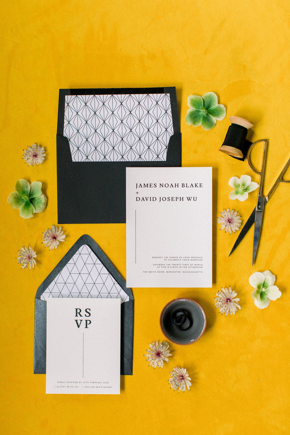 The wedding stationery was done in black and white and placed on a yellow runner to mark the wedding color scheme