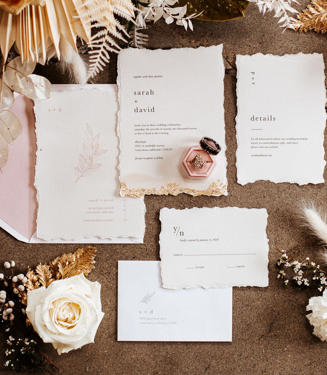 The wedding stationery was done with a raw edge and gold leaf