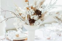 02 a textural wedding centerpiece of cotton branches, lunaria, branches and some dried berry branches