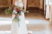 03 The bride was rocking a lace halter neckline and train wedding dress and carrying a bold bouquet