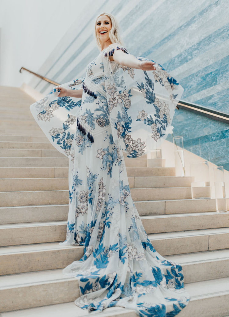 The bride was wearing a fantastic wedding gown in blues, with tassels and a train