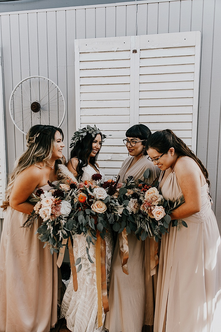 The bridesmaids were wearing mismatched nude maxi dresses