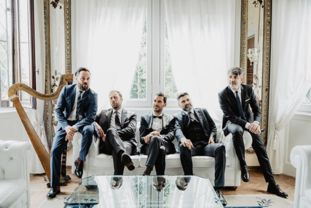 The groomsmen were rocking mismatching suits with ties