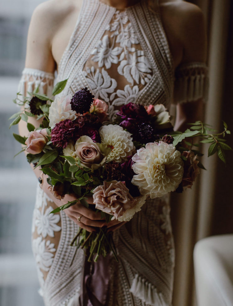 The wedding bouquet was a moody one, with some greenery