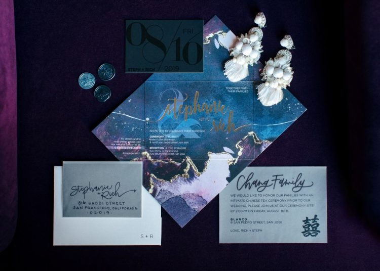 The wedding stationery was done moody, with watercolors and gold leaf