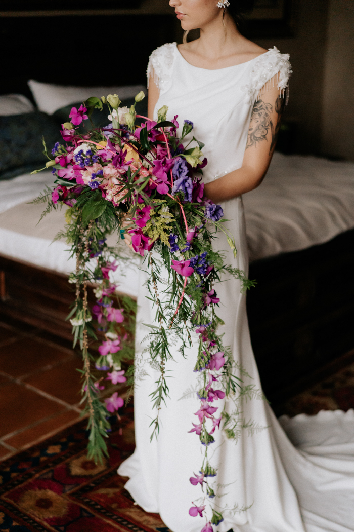 The bride was wearing a plain fitting wedding dress with fully embellished sleeves
