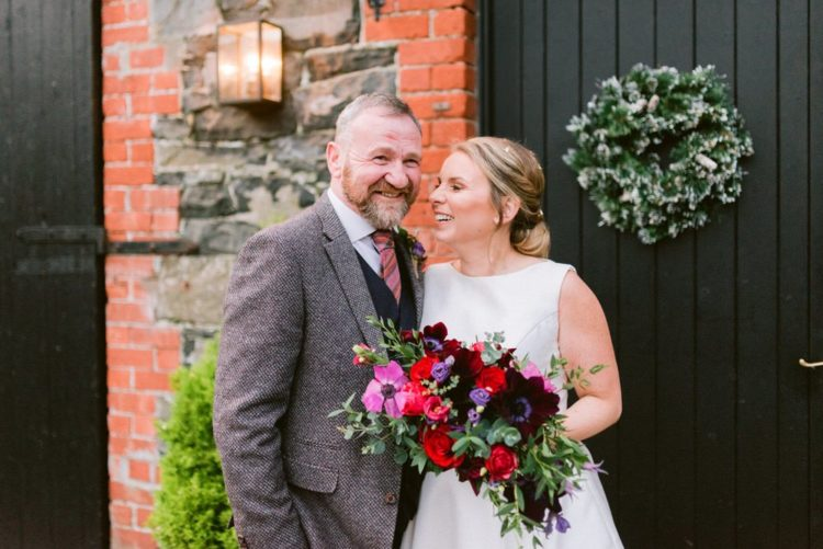 The groom was rocking black pants, a waistcoat, a tweed blazer and a striped tie