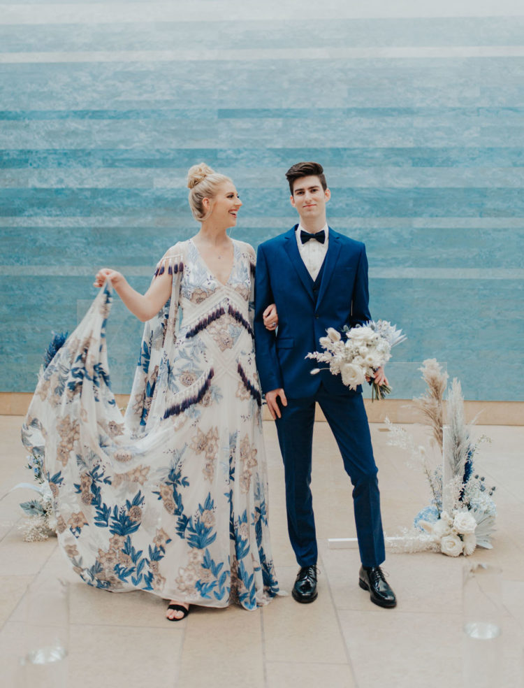 The groom was wearing a bold blue three-piece suit, with a black bow tie and black shoes