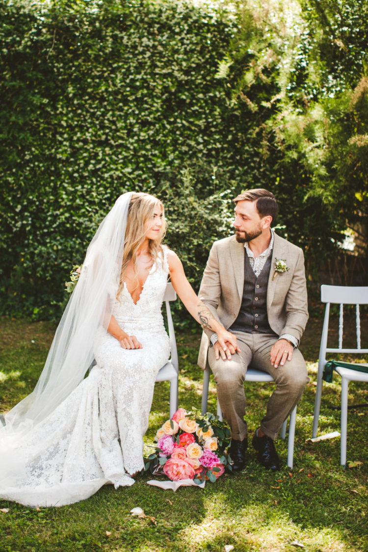 The groom was wearing a tan suit, a printed shirt and a grey waistcoat plus black shoes
