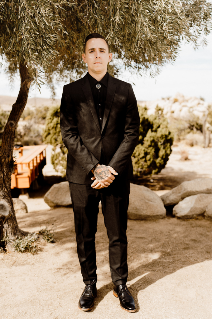 The groom was wearing a total black look with a bolo tie and shoes