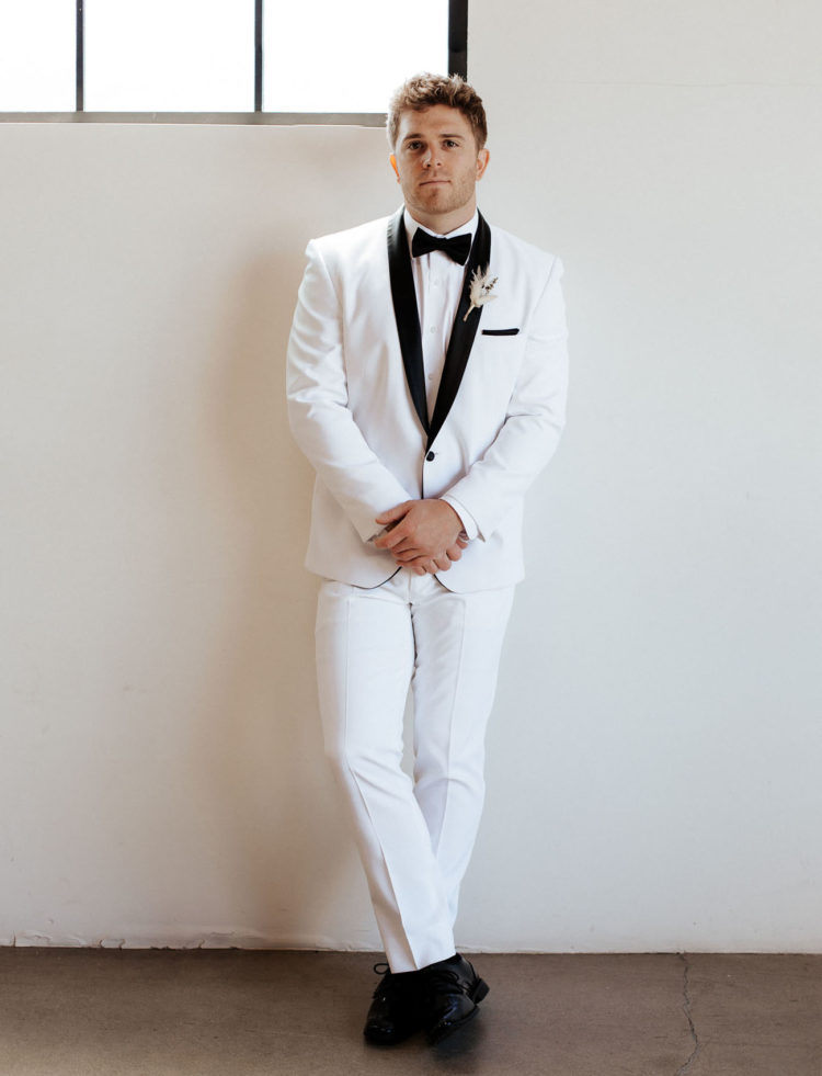 The groom was wearing a white tux with black lapels