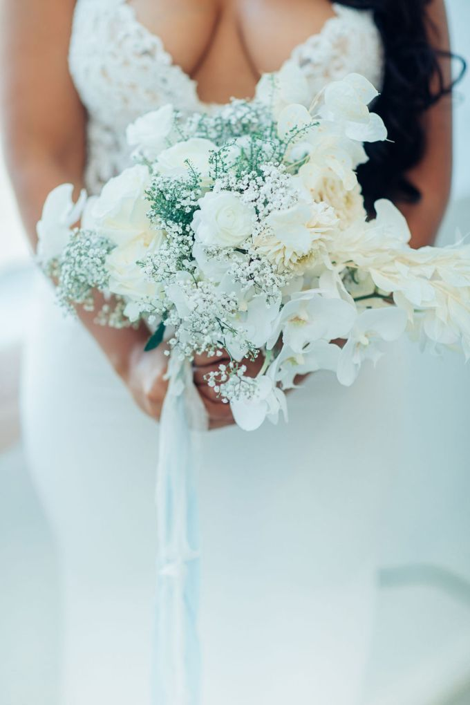 The wedding bouquet was done wiht white roses, orchids and baby's breath for a chic touch