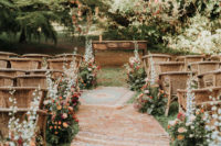 04 The wedding ceremony space was done super bright, with bold blooms, greenery and boho rugs
