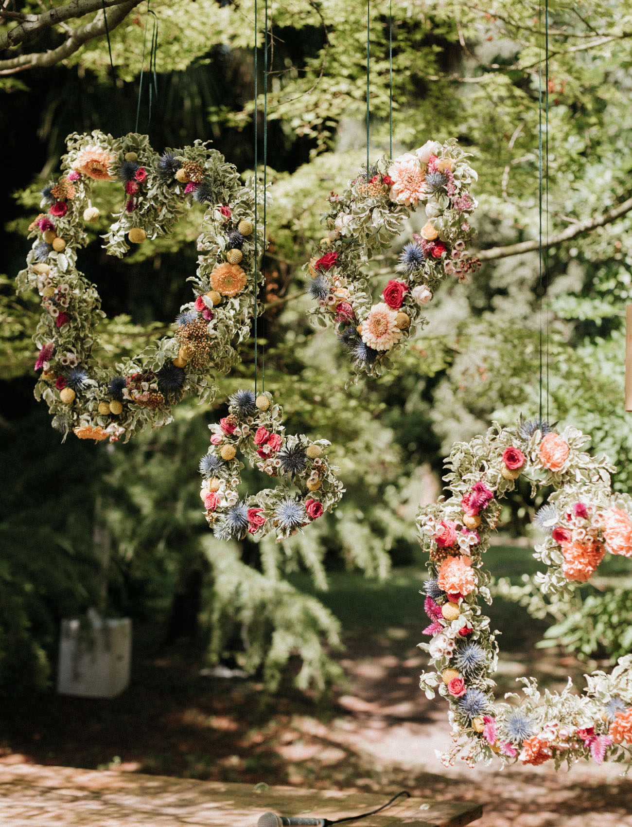 I love these pretty colorful hearts of greenery and bright flowers