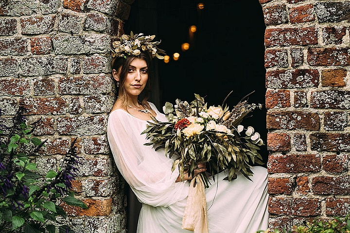 The bride also tried on a chic floral crown and a lush wedding bouquet that matched it