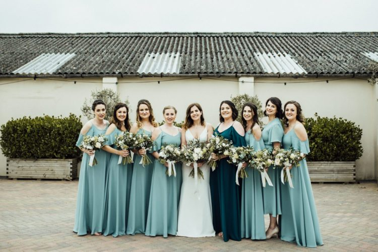 The bridesmaids were wearing light blue cold shoulder dresses and a teal one for the maid of honor
