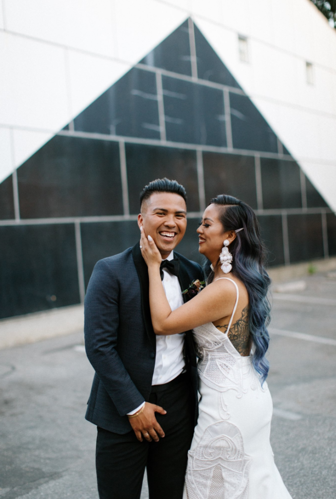 The groom was rocking a modern tux with black lapels