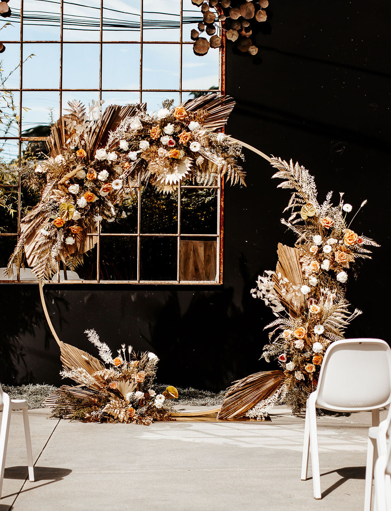 The wedding arch was an incredible one, with peachy blooms, fronds, herbs and leaves