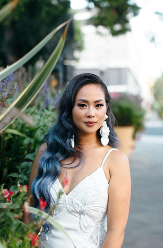 The bride made her look bold with blue hair and statement earrings
