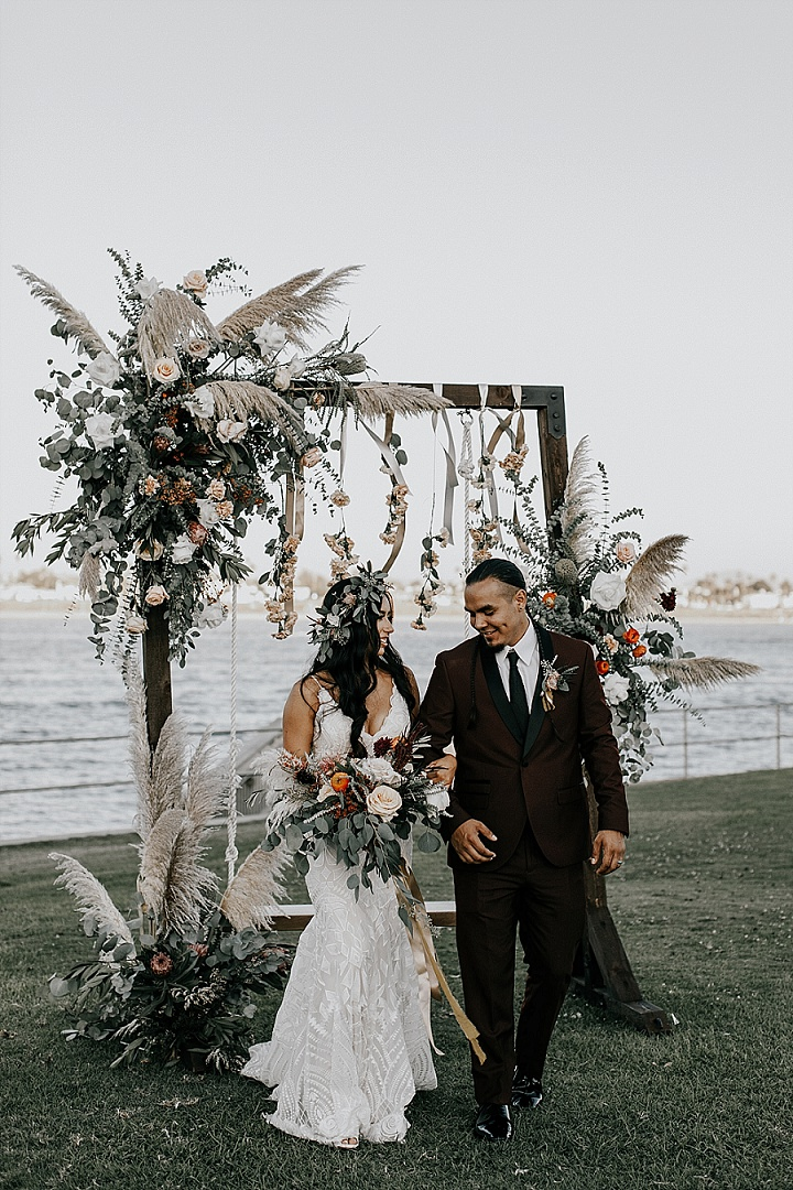 The bride was wearing a beautiful fitting boho wedding dress of lace and a greenery crown