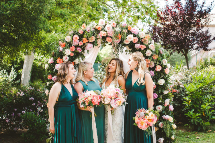 The bridesmaids were wearing green maxi dress with drapings